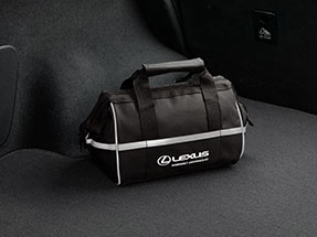 Black emergency assistance kit with the Lexus logo and name.