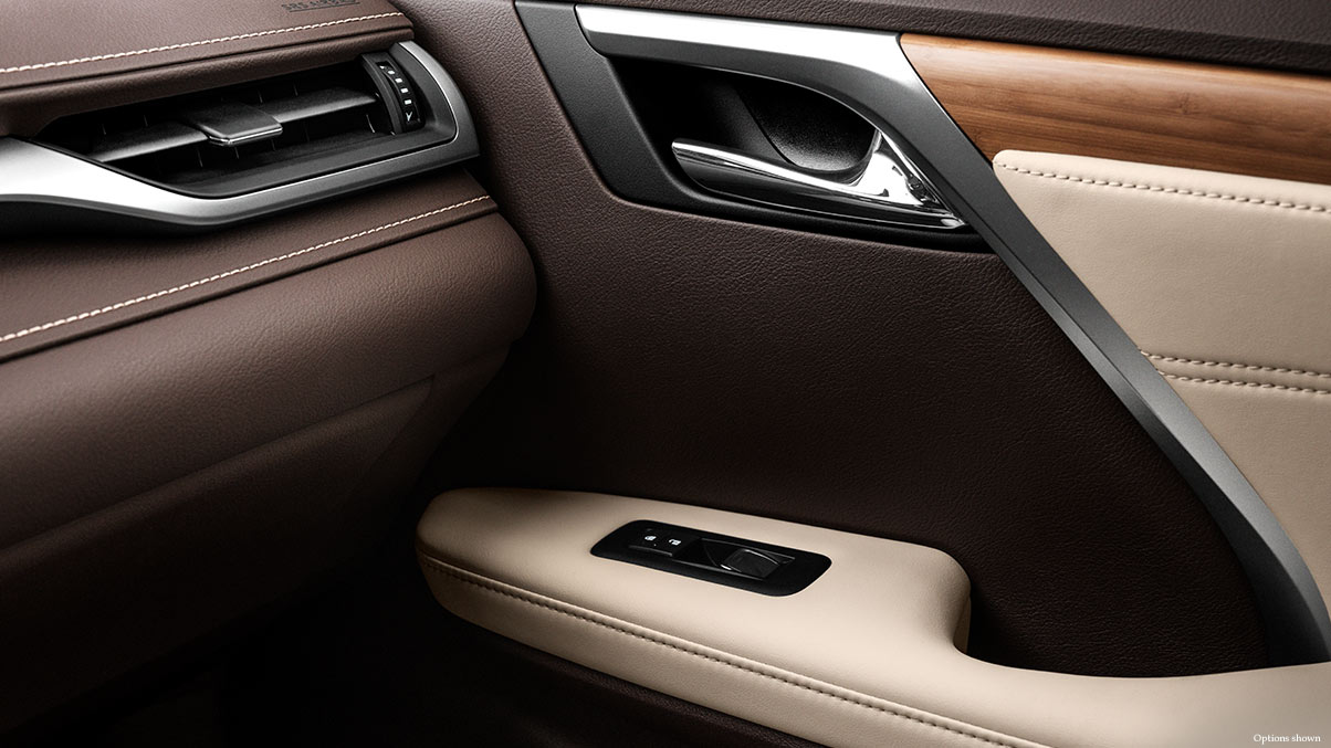 Interior shot of the 2018 Lexus RX shown with Semi-Aniline perforated leather trimmed interior