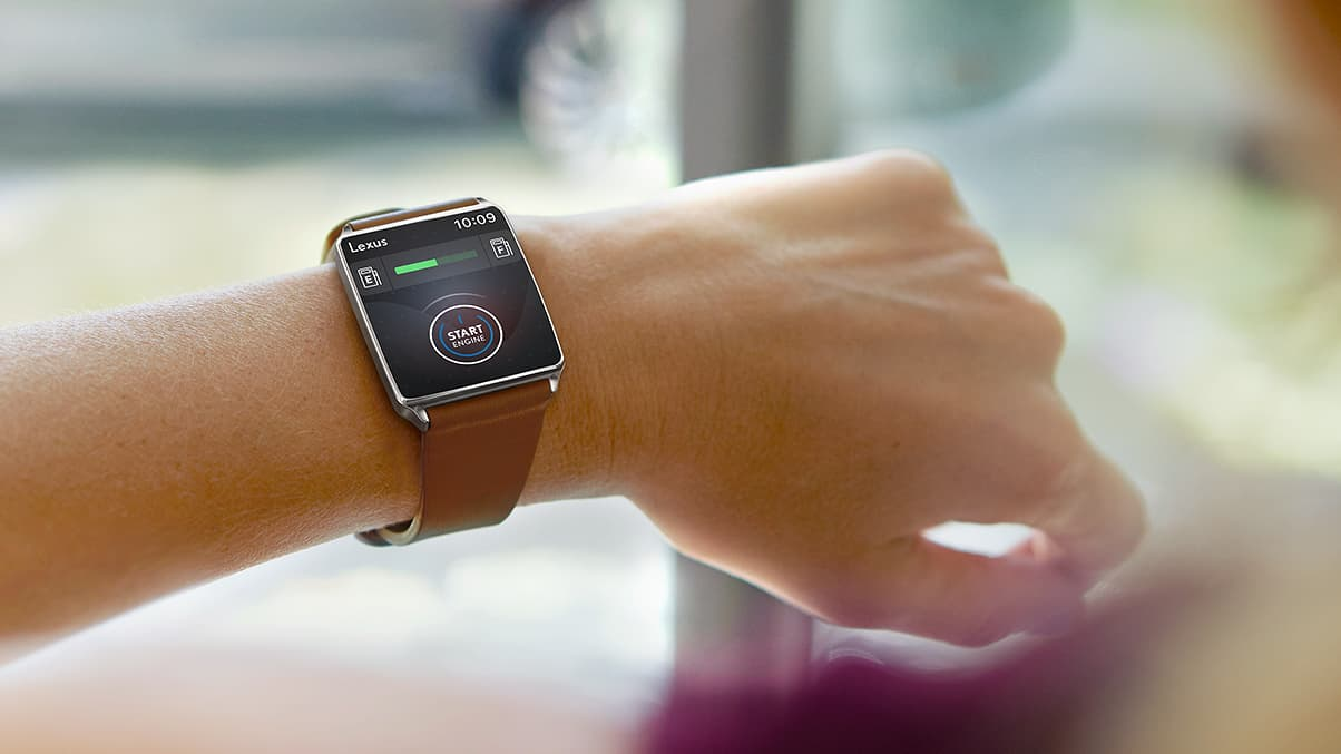 Smartwatch showing the Lexus Enform Remote capability being used.
