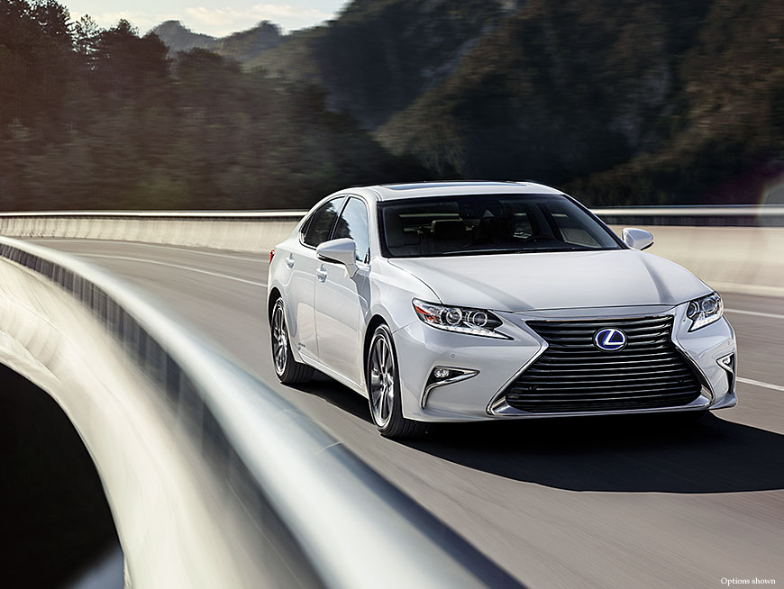 Exterior shot of the 2018 Lexus ES shown in Eminent White Pearl.