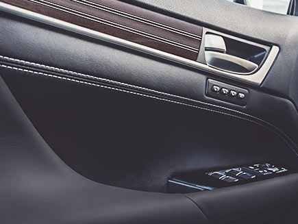 Interior shot of the Lexus GS shown in Black Leather with Gray Sapele wood and Aluminum trim.