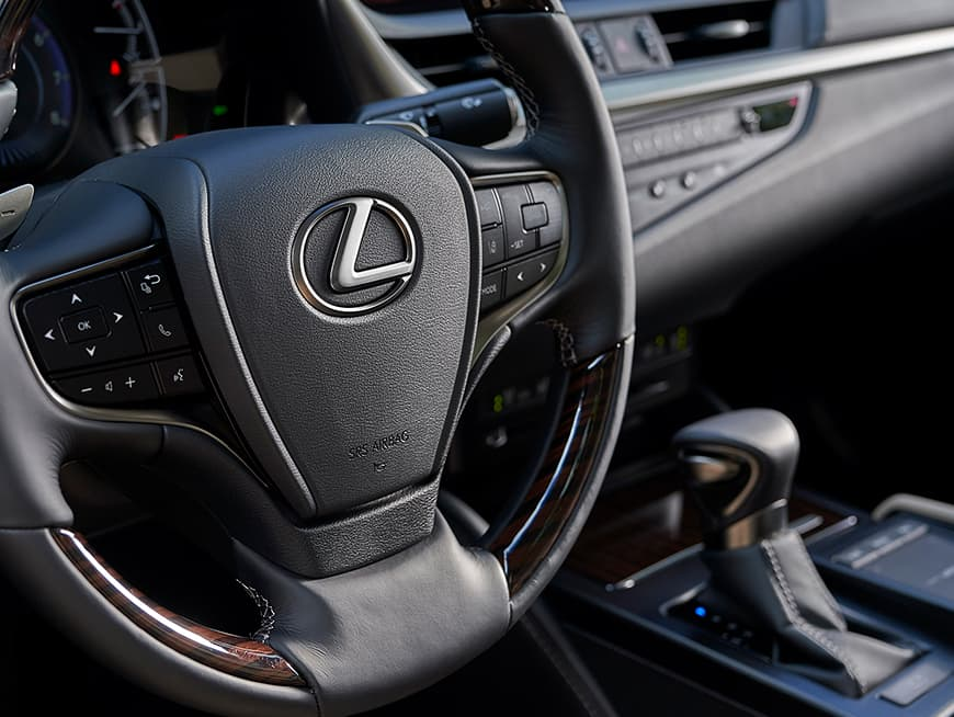 Interior of the Lexus ES hybrid showing the precision-crafted steering wheel.
