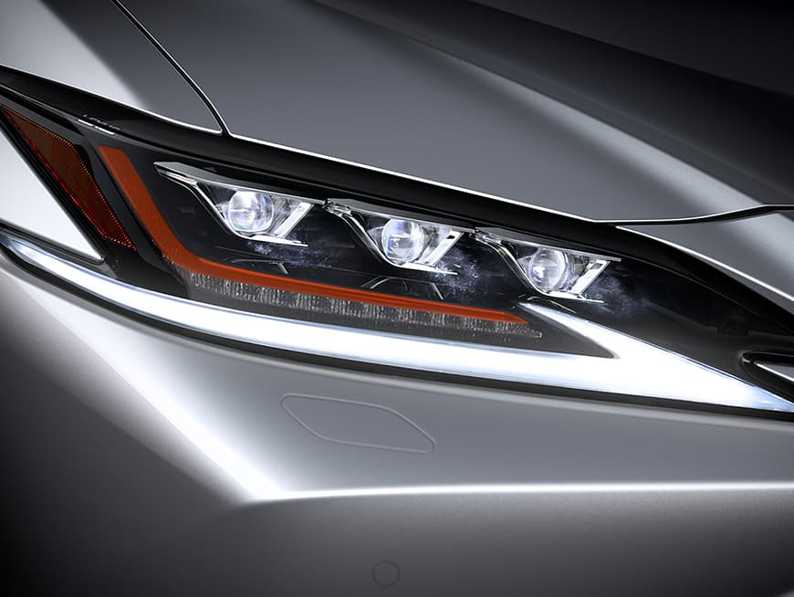 Exterior shot of the Lexus ES showing the available Premium Triple-Beam LED headlamps.