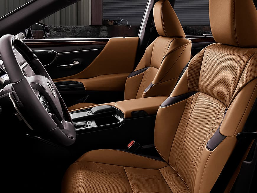 Interior shot of the Lexus ES Hybrid shown in Flaxen leather with Linear Espresso wood trim.