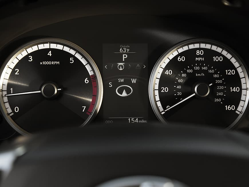 Interior of the Lexus NX showing the multi-information display in the gauge cluster.