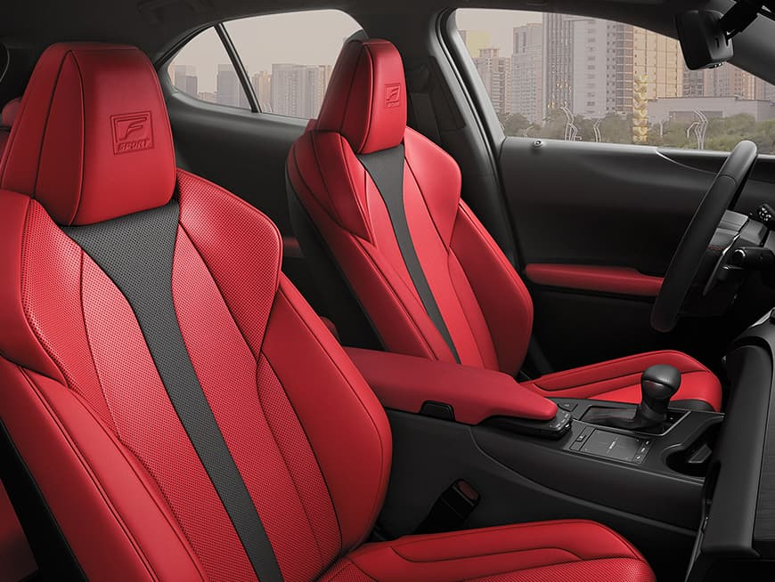 Interior of the Lexus UX F SPORT shown in Circuit Red NuLuxe with Black dash.