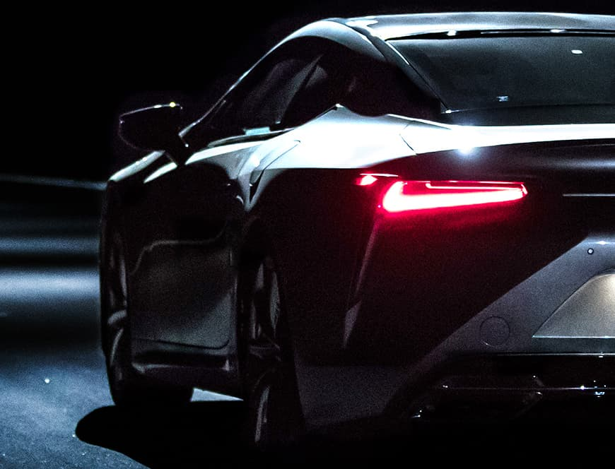 Rear shot of the Lexus LC 500 with illuminated taillamps.
