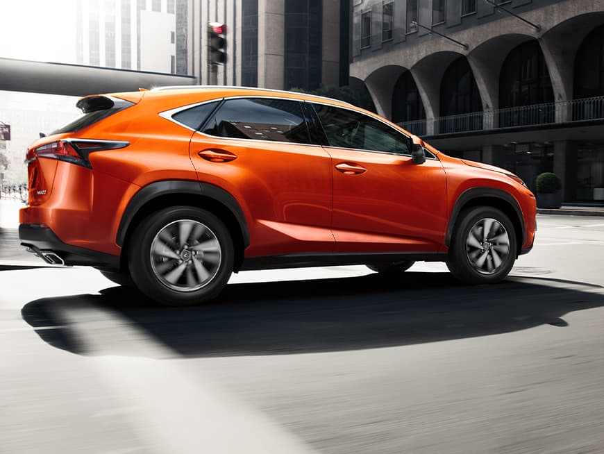 Lexus NX shown in Cadmium Orange.