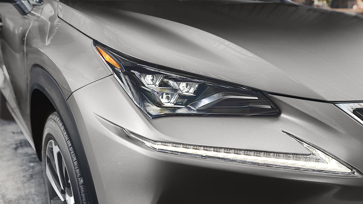 Available Premium Triple-Beam LED headlamps shown on the Lexus NX in Atomic Silver.