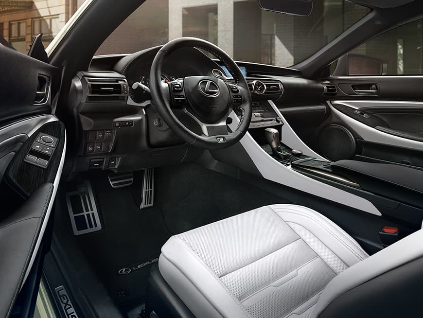 Interior of the Lexus RC shown in White NuLuxe with Dark Gray Streamline trim.