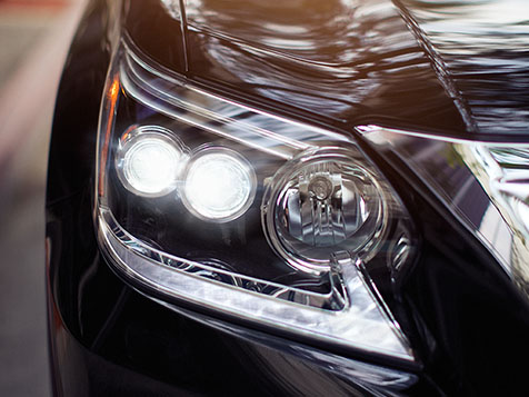 Exterior shot of the 2018 Lexus GX 460 headlamp and daytime running lights.