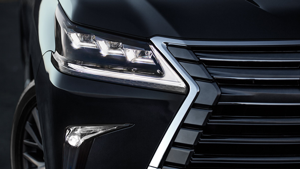 Detail shot of the Lexus LX Premium Triple-Beam LED headlamps.