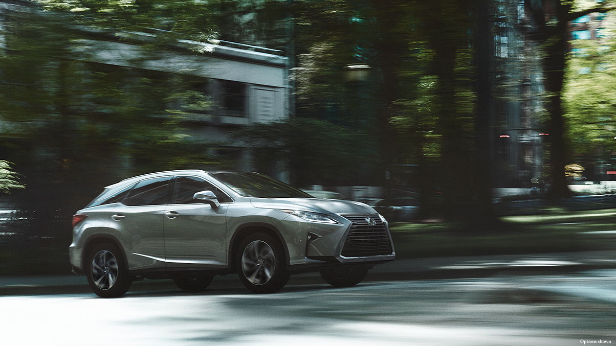 Exterior shot of the 2018 Lexus RX shown in Silver Lining Metallic.