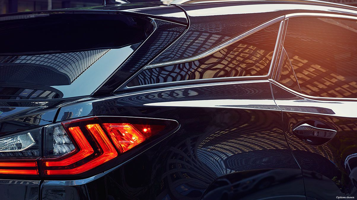Exterior shot of the 2018 Lexus RX F Sport LED taillamps.