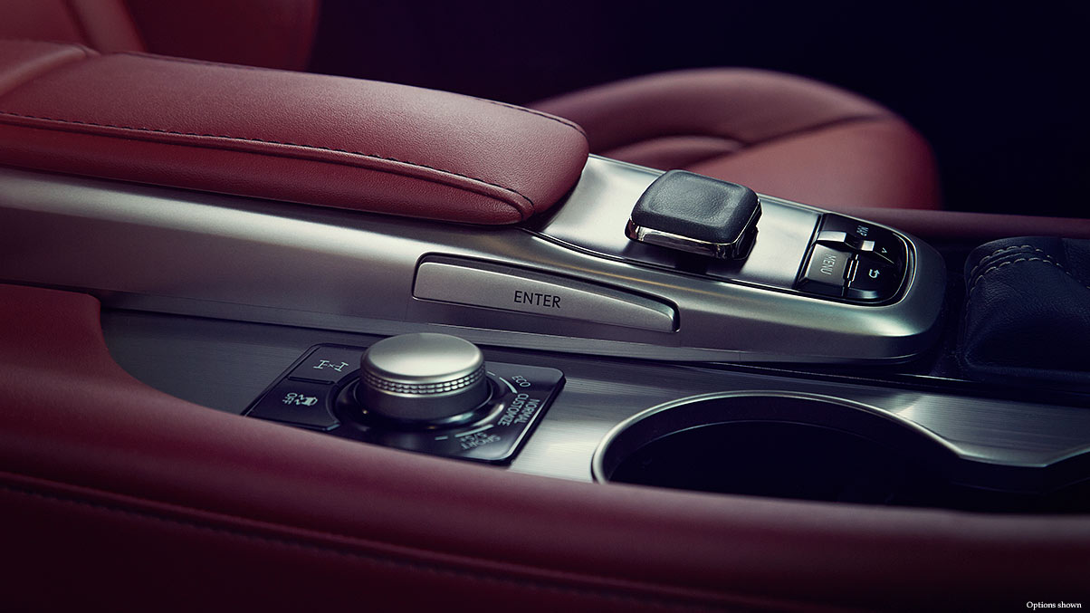 Interior shot of the 2018 Lexus RX F Sport Drive Mode Select and available Remote Touch.