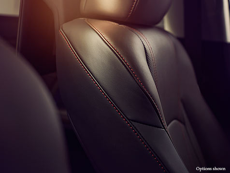Interior shot of the 2018 Lexus RX Hybrid contrast stitching for available Noble Brown leather trim.
