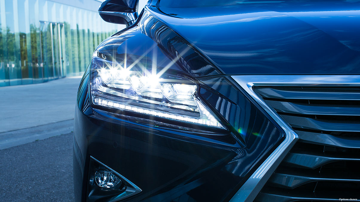 Exterior shot of the 2018 Lexus RX Hybrid available Premium Triple-Beam LED headlamps.
