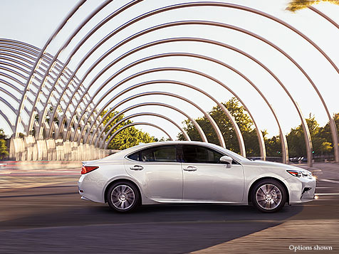 EXTERIOR shot of the 2018 Lexus ES Hybrid shown in Eminent White Pearl.