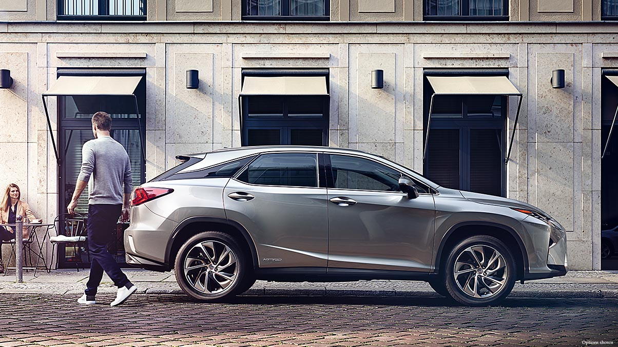 Exterior shot of the 2018 Lexus RX Hybrid shown in Atomic Silver.