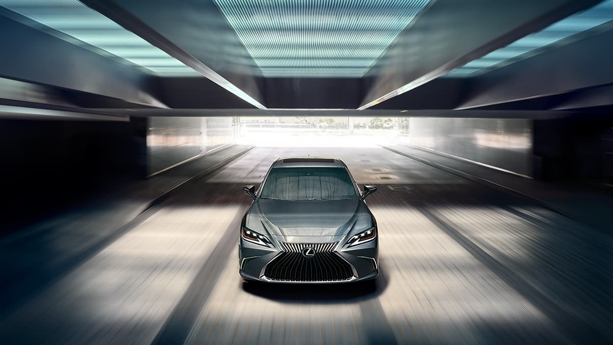 Exterior shot of the 2019 Lexus ES shown in Nebula Gray Pearl.