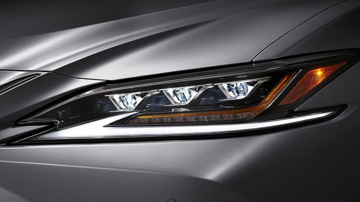 Exterior shot of the 2019 Lexus ES shown with Available Premium Triple-Beam LED Headlamps.