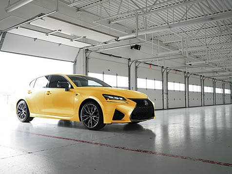 Exterior shot of the 2019 Lexus GS F shown in Flare Yellow.