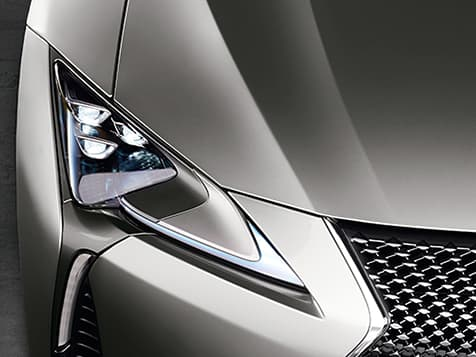 Detail shot of the Lexus LC shown in Atomic Silver featuring the Premium Triple-Beam LED headlamps.
