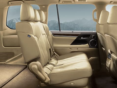 Interior shot of the 2019 Lexus LX in available Parchment leather and Linear Dark Mocha wood trim.