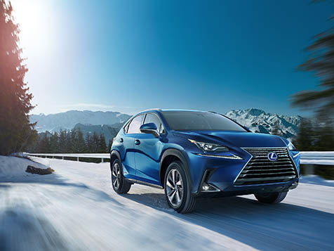 Exterior shot of the 2019 Lexus NX Hybrid shown in Blue Vortex Metallic