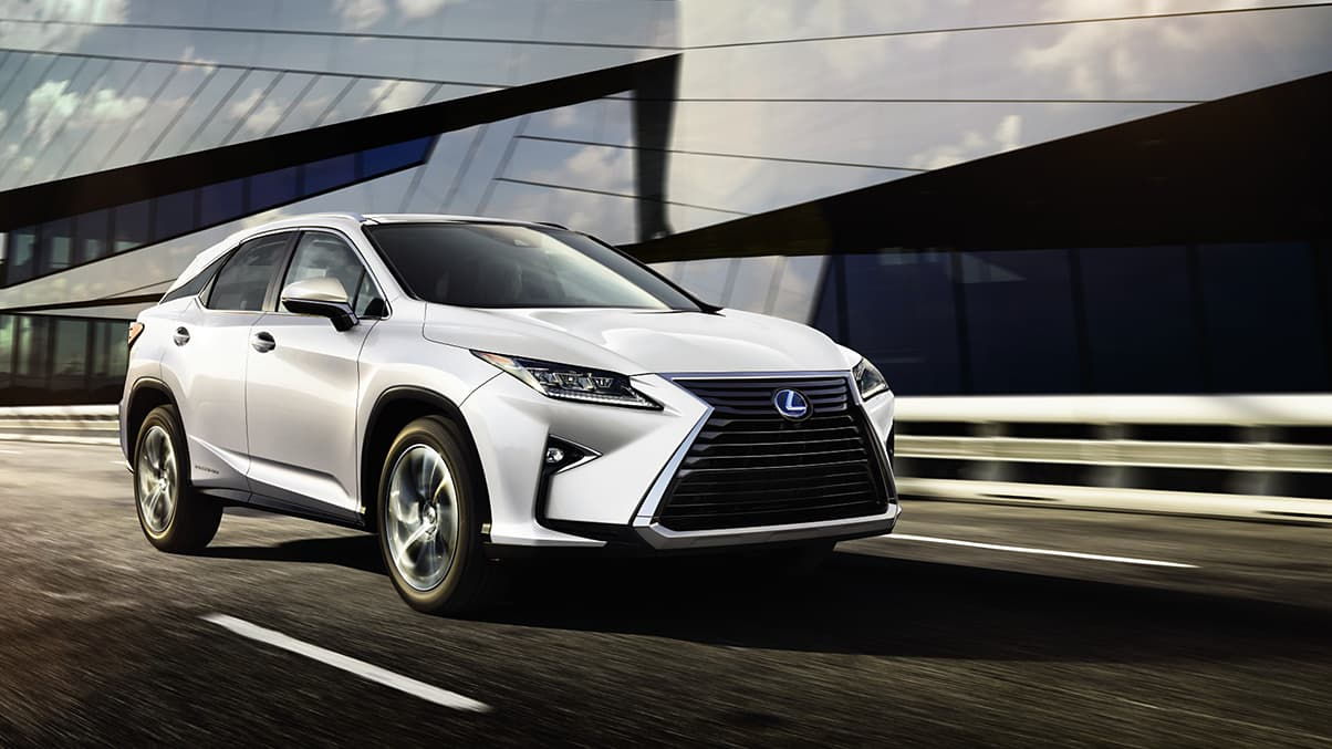 Exterior shot of the 2019 Lexus RX Hybrid shown in Eminent White Pearl.