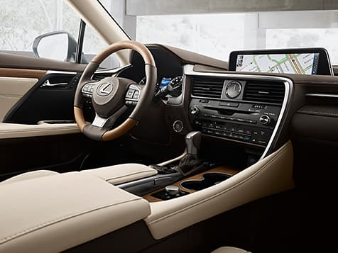 Interior shot of the 2019 Lexus RX shown with available Parchment leather and Matte Bamboo trim.