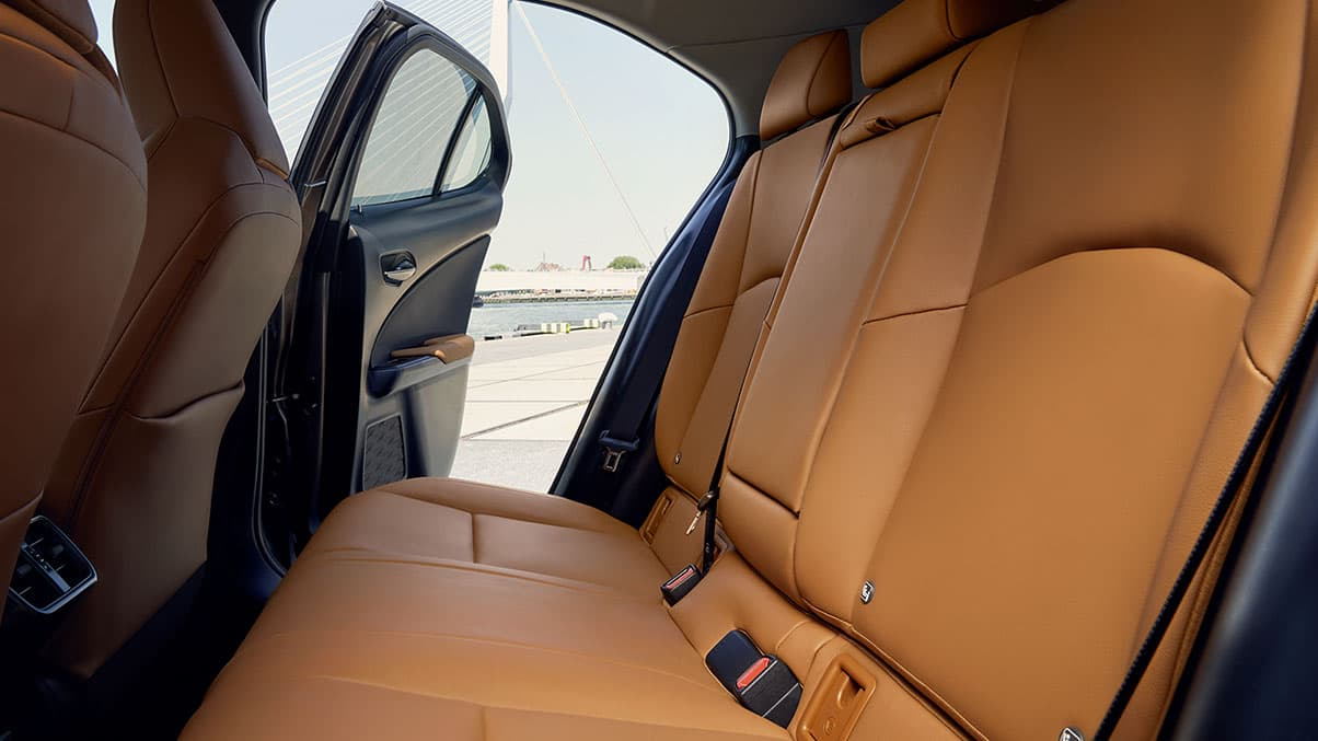 Interior shot of the 2019 Lexus UX with Glazed Caramel NuLuxe® interior trim.
