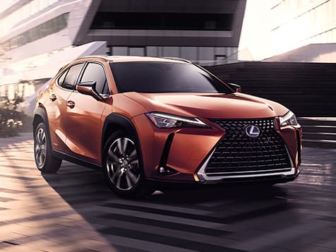 Exterior shot of the 2019 Lexus UX shown in available Cadmium Orange.