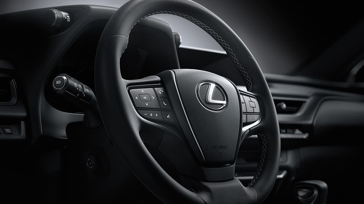 Interior shot of the 2019 Lexus UX shown with leather-trimmed steering wheel with Black NuLuxe® interior trim.