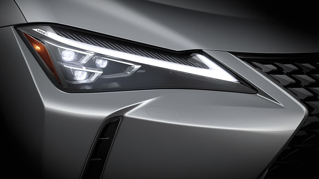 Exterior shot of the 2019 Lexus UX shown with Available Premium Triple-Beam LED Headlamps.