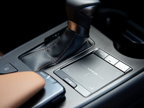 2019 Lexus UX interior shown with convenient center-console with Remote Touchpad.