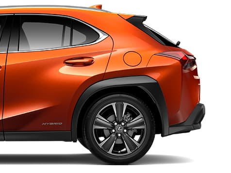 Exterior shot of the 2019 Lexus UX Hybrid shown in available Cadmium Orange.