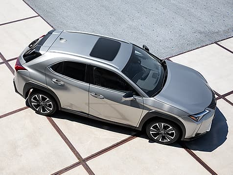 Exterior shot of the 2019 Lexus UX Hybrid shown in Silver Lining Metallic.
