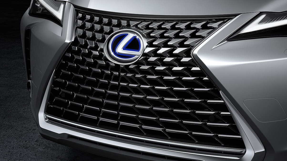 2019 Lexus UX Hybrid shown with Lexus spindle grille with unique mesh pattern.