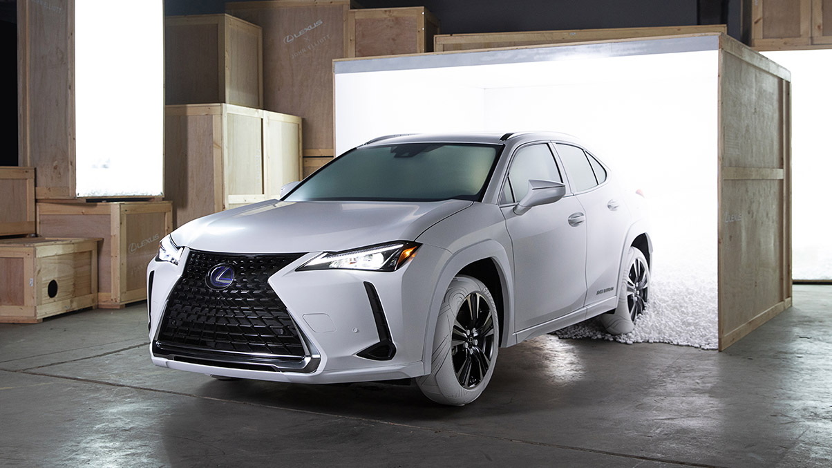 The 2019 Lexus UX shown in Ultra White with LEXUS x JOHN ELLIOTT tires inspired by the iconic JOHN ELLIOTT x NIKE AF1 sneaker.