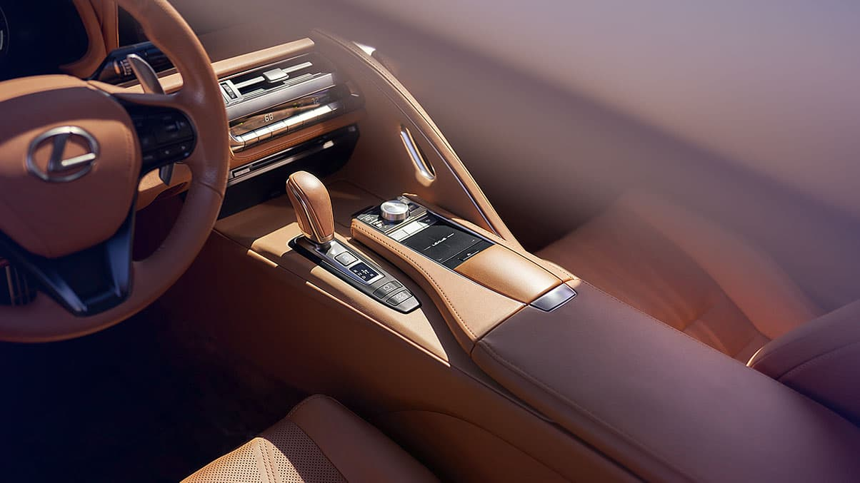 Interior detail shot of the Lexus LC 500h featuring the leather-wrapped shift knob.