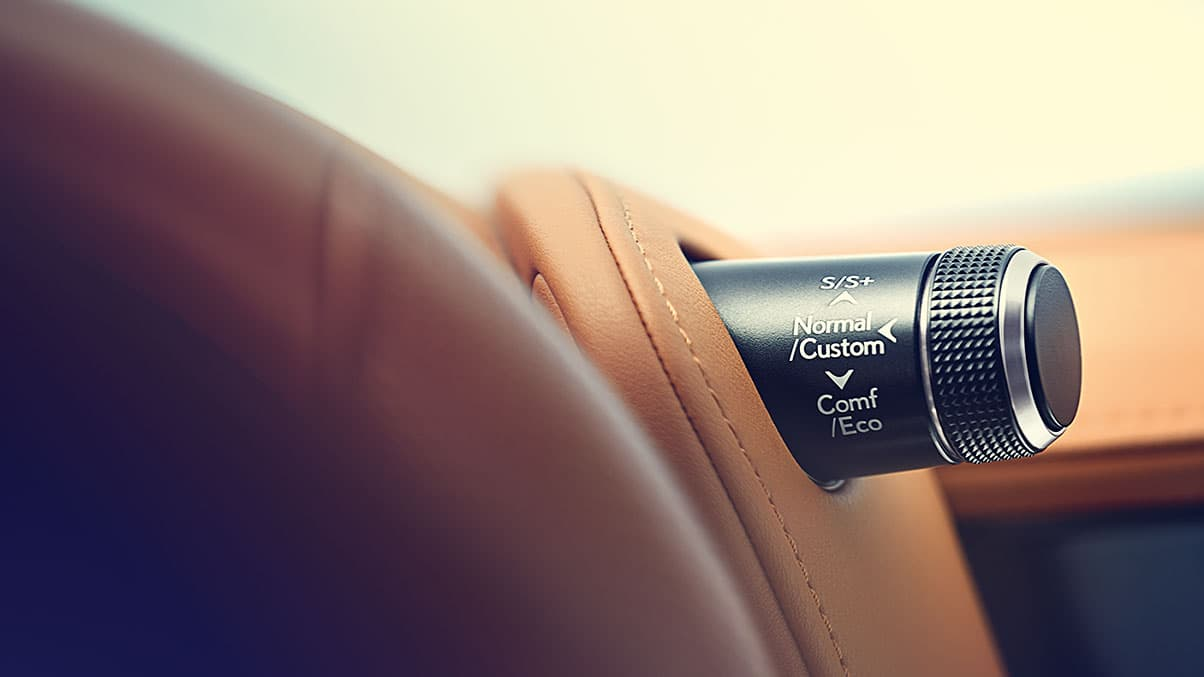 Lexus LC 500h interior detail shot featuring the Drive Mode Select knob.