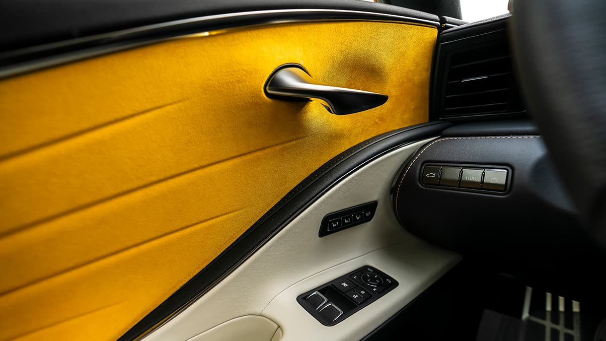 Interior of the 2019 LC Inspiration Series shown with Bespoke Yellow Alcantara door inserts.