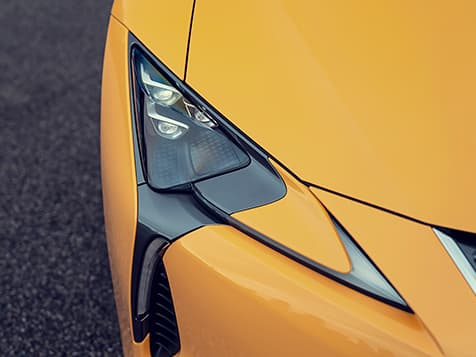 Detail shot of the 2019 LC Inspiration Series shown in Flare Yellow featuring the Premium Triple-Beam LED headlamps.