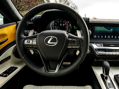 Interior of the 2019 LC Inspiration Series showing the leather-wrapped steering wheel and magnesium paddle shifters.