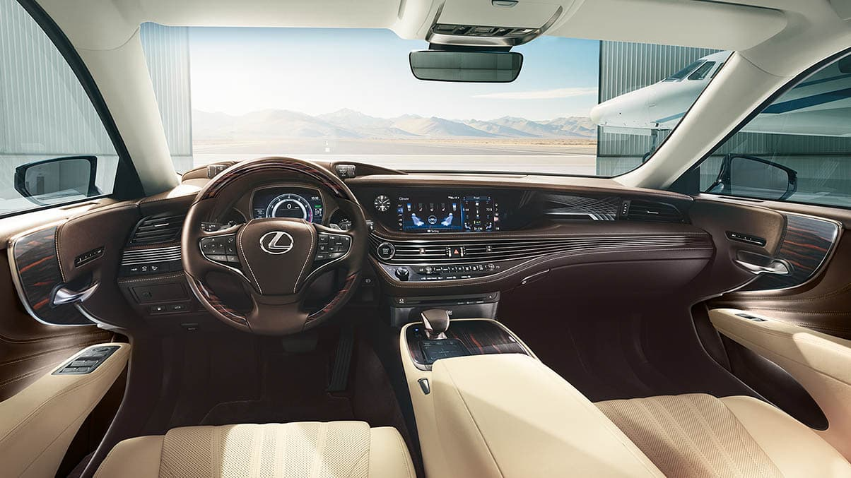 Interior of the Lexus LS shown with Parchment leather and available Art Wood Organic interior trim.