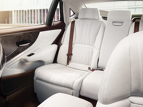 Interior of the Lexus LS shown with available White leather and Art Wood Herringbone interior trim.