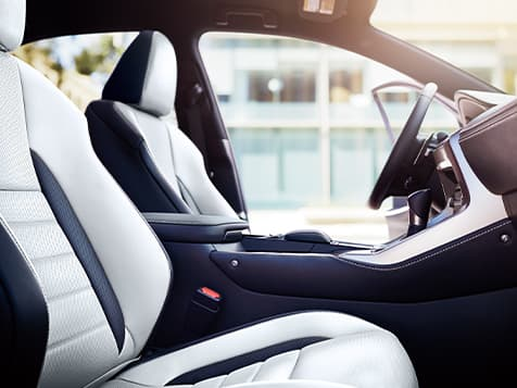Interior of the Lexus NX F SPORT shown with Arctic White trim.