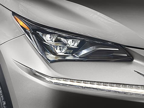 Detail shot of the available Premium Triple-Beam LED headlamps shown on Atomic Silver NX.