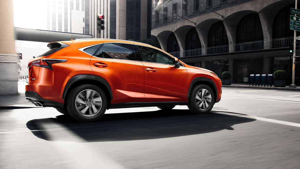 Lexus NX shown in available Cadmium Orange.